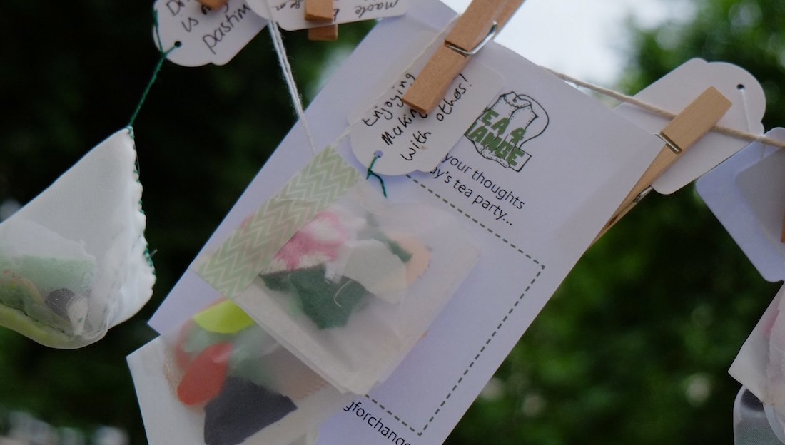 tea bags and comment cards hanging from pegs/string