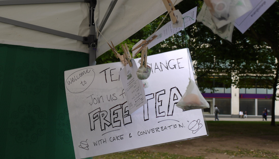 sign with: 'welcome to Tea 4 Change, Join us for free tea with cake and conversation'